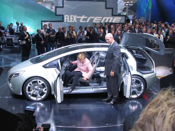Angela Merkel CO2 limit for cars Thursday September 13th at 11:39 at the fair booth of Opel on the IAA. Merkel takes place in the prototype, which shows, that the CO2 limits for the car industry